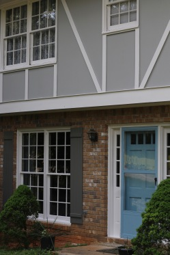 Cool grays and white freshen up this tudor revival